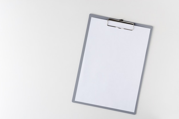 Clipboard with a blank sheet of paper