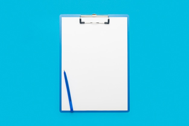 Clipboard with a blank sheet and a pen on a light blue