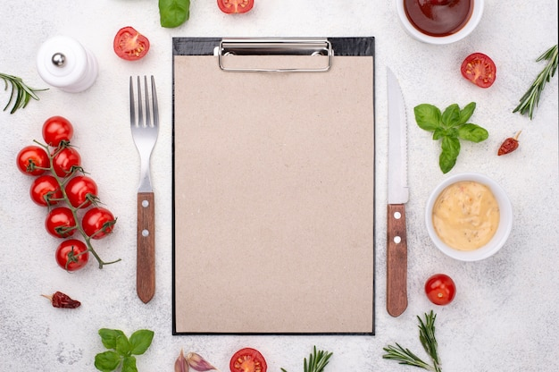 Clipboard with cutlery and ingredients