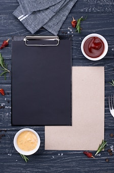 Clipboard with cutlery  setting and souces