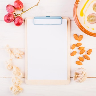 Clipboard with food on kitchen table