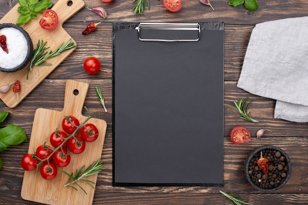 Clipboard with ingredients beside