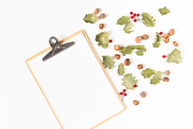Clipboard with leaves and chestnuts