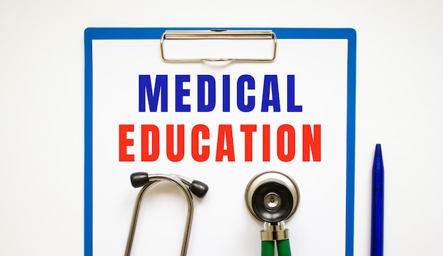 Clipboard with page and text medical education, on a table with a stethoscope and pen