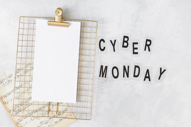 Clipboard with paper near cyber monday title