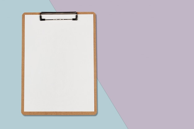 Clipboard with white sheet on pastel color background, minimal concept