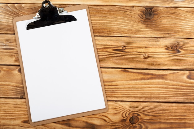 Clipboard on wood background