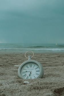 Clock on the beach sand