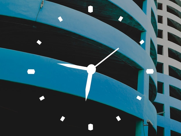 Clock over a building setting