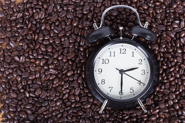 Clock and coffee beans (coffee time concept)