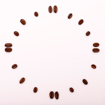 Clock of coffee beans. framed background with copyspace