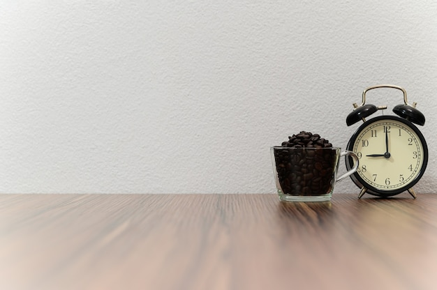 Clock and coffee beans placed at the desk