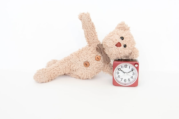 The clock and a cute teddy bear show some simple yoga pose to stretch and strengthen.
