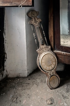 Clock on the floor in abandoned house
