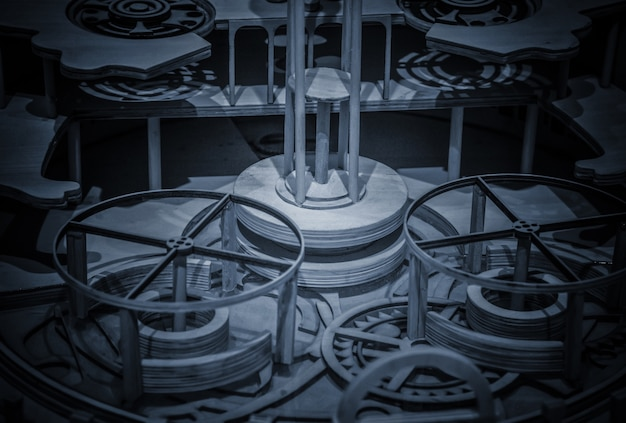 Часовой механизм, выполненный в технике тонирования. очень малая глубина резкости. сосредоточьтесь на центральных передачах