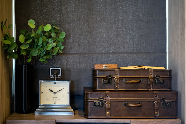 Clock and old leather suitcase in the bedroom. bedroom modern design. interior design.