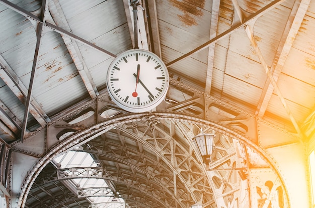 Clock at the railway station. concept of meeting, waiting, seeing people on the road trip.