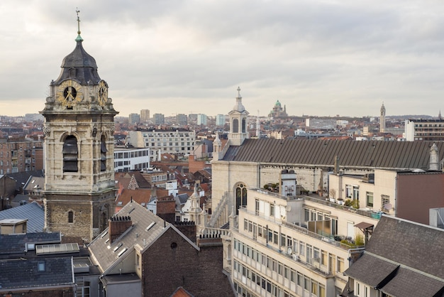 Clock tower of church saint catherine and views of the brussels, belgium