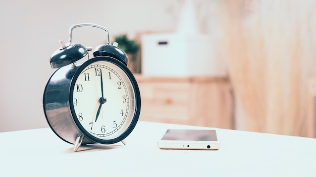 Clock on white table.