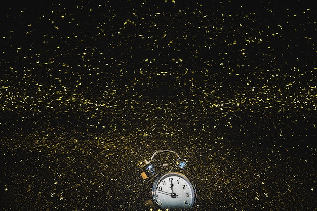Clock with falling sequins