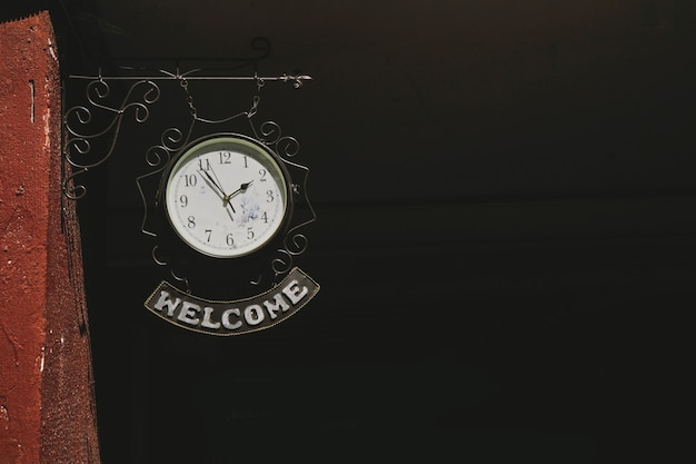 Clock with label welcome. red courtyard in minsk