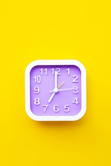 Clock on yellow background.