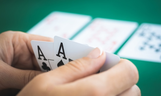Cloe up on pair of aces in hands of gambler