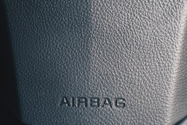 Clos up airbag sign on a cars dashboard