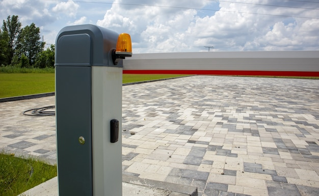 Close the gate. automatic security system. automatic entry system. yellow light signal with a street barrier. barrier gates automatic security system.