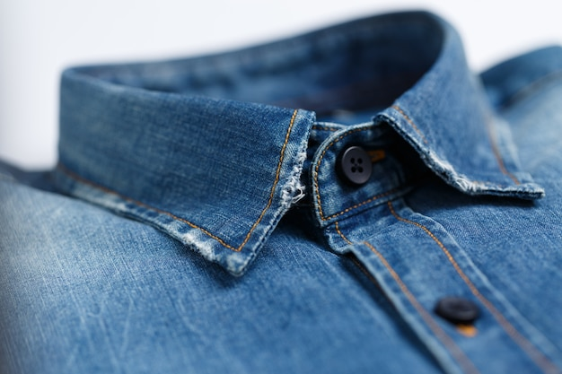 Close op shot of the collar of a classy, ironed blue denim male shirt