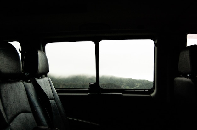 Close-range shot of two car seat near the window inside of a vehicle