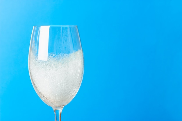 Close shot of a wine glass in lather.