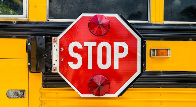 Close of a stop sign on the back of school bus