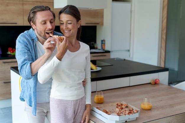 Close u pon couple at home sharing tender moments