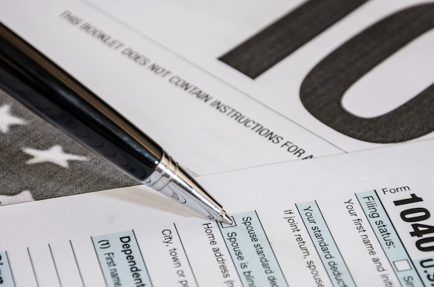 Close up of 1040 tax forms and pen