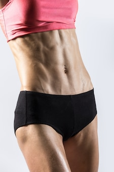 Close-up of abs of beautiful athletic woman