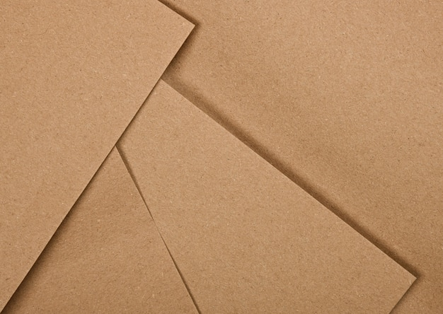 Close up abstract background of several natural brown paper sheets for design craft