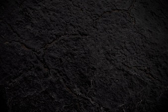 Close up abstract black cracked background texture of asphalt road can be used for backdro