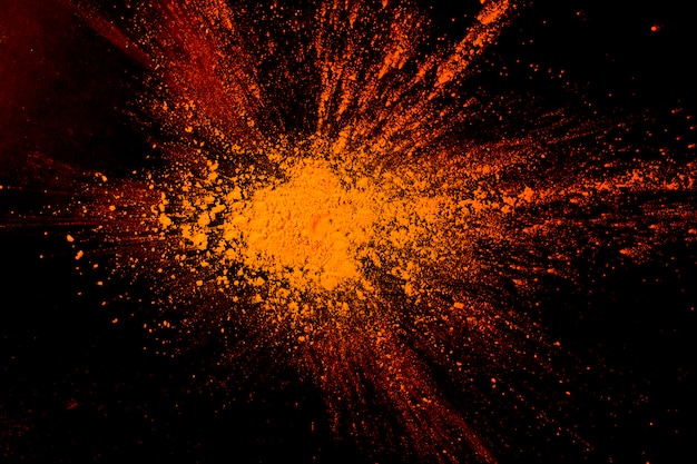 Close-up of abstract orange powder paint background