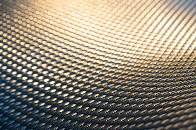 Close up the abstract pattern of rattan chair when the golden sun light reflection on
