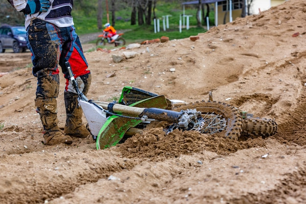 Close-up of accident in mountain bikes race in dirt track