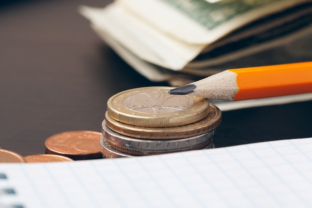 The close-up of accounting documents with money coins