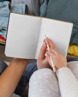 Close up adult teaching kid to write