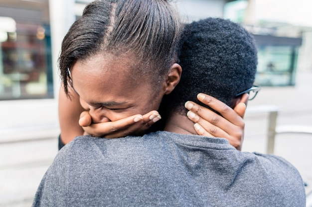 Close-up of african american young couple kissing outdoors in summer