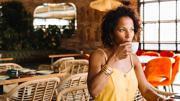 Close-up of an african american young woman drinking coffee