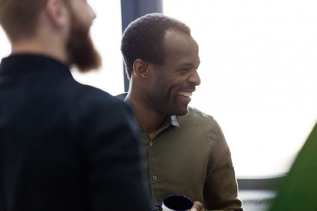 Close up of a african man standing with his colleagues