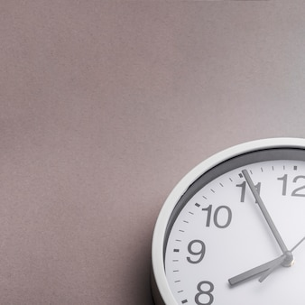 Close-up of alarm clock against gray background