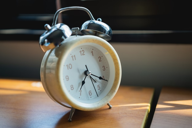 Close up of alarm clock on wood office table