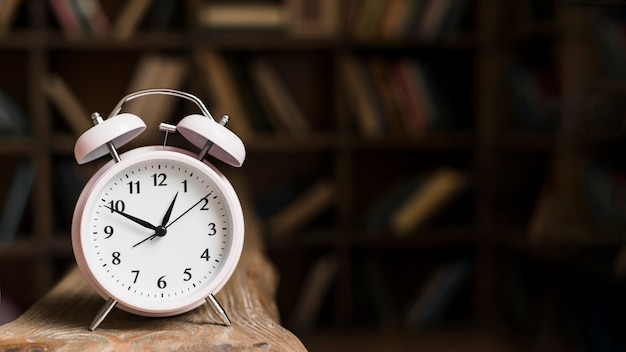 Close-up of a alarm clock on wooden desk