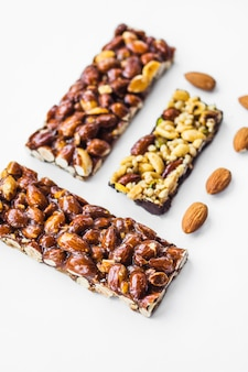 Close-up of almonds bar on white background
